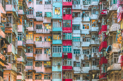 Facade of Monster building in Hong Kong, Quarry Bay during sunset.