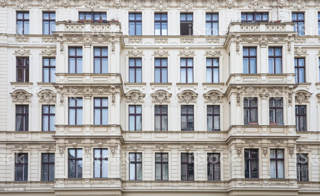 Facade of Old Apartment Bulding, Multiple Windows, Berlin stock photo