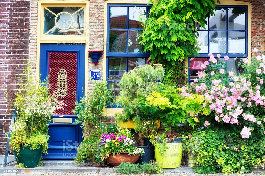 Facade of old house decorated with flowers, Brielle, Netherlands, Europe stock photo