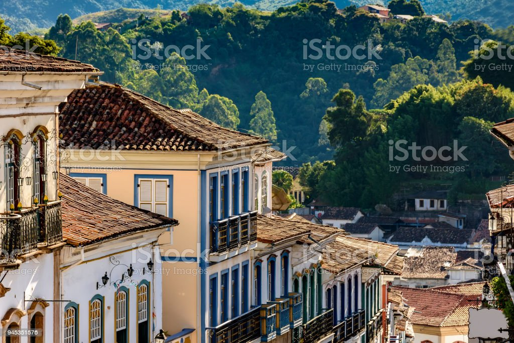 Facade of old houses built in colonial architecture with their...