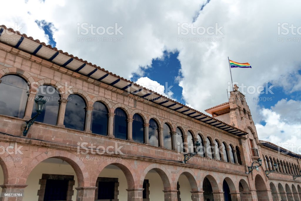 Facade of the city hall of Cusco (Peru) with local flag - Royalty-free Ancient Stock Photo