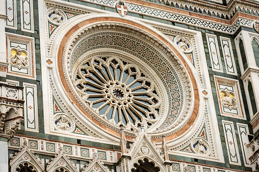 Florence Cathedral, Duomo of Santa Maria del Fiore, closeup of the Main Facade with the Rose Window. UNESCO world heritage site, Tuscany, Italy, Europe