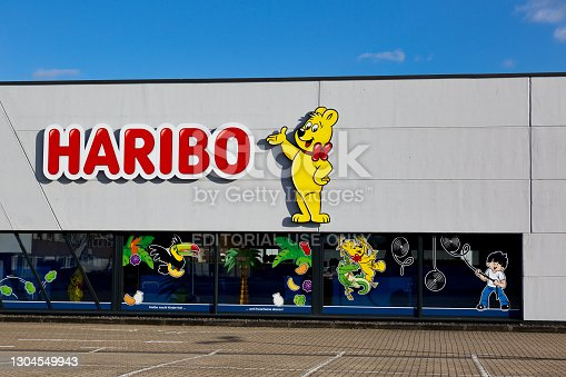 istock facade of the Haribo Outlet Store with the famous yellow Haribo bear. Haribo is a German confectionery company 1304549943