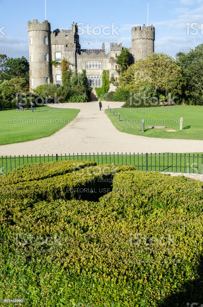 Facade of the Malahide Castle in Ireland during day of autumn stock photo