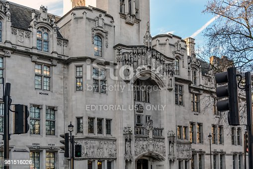 The art nouveau Gothic facade of The Middlesex Guildhall which is the home of the Supreme Court of the UK. The exterior of the building is decorated with corner turrets, a piecework parapet, and many ornamental statues by sculptor Henry Fehr. The impressive relief frieze and statues are over the entrance.