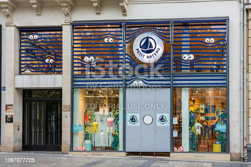 PARIS, FRANCE - AUGUST 15, 2020: Facade of the Petit Bateau store on the avenue des Champs-Elysées. Petit Bateau is a French brand of clothing and underwear mainly for children