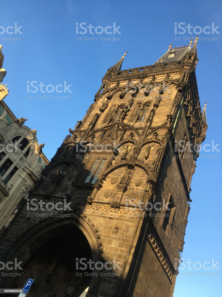 Facade of the Powder Tower (Prasna brana), medieval gate from the 15th Century in Prague, separating Old Town from New Town, Prague Czech Republic. Exterior of the Powder Tower lit with warm sunlight. stock photo