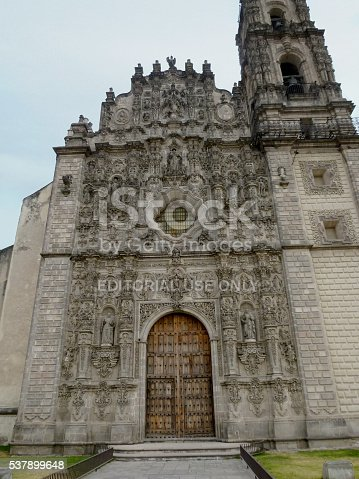 Tepotzotlán, Mexico - January 01, 2013: Facade of the San Francisco Javier Church which is no longer used for religious services and is now part of the Museo Nacional del Virreinato. His impressive interior contains one of the most important collections of Churrigueresque altarpieces in Mexico.