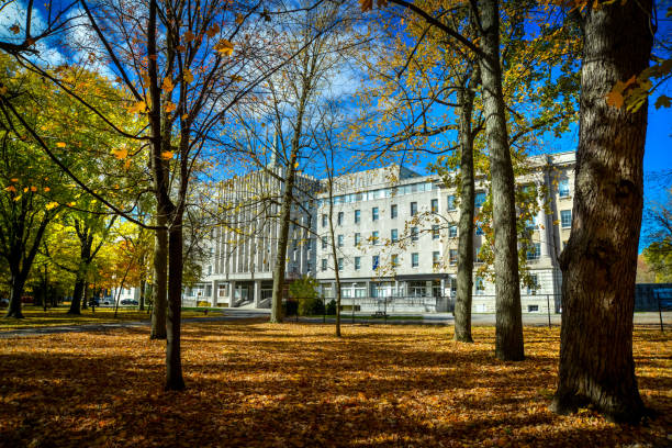 Facade of the Seminary of Saint-Hyacinthe through colorful trees in autumn stock photo