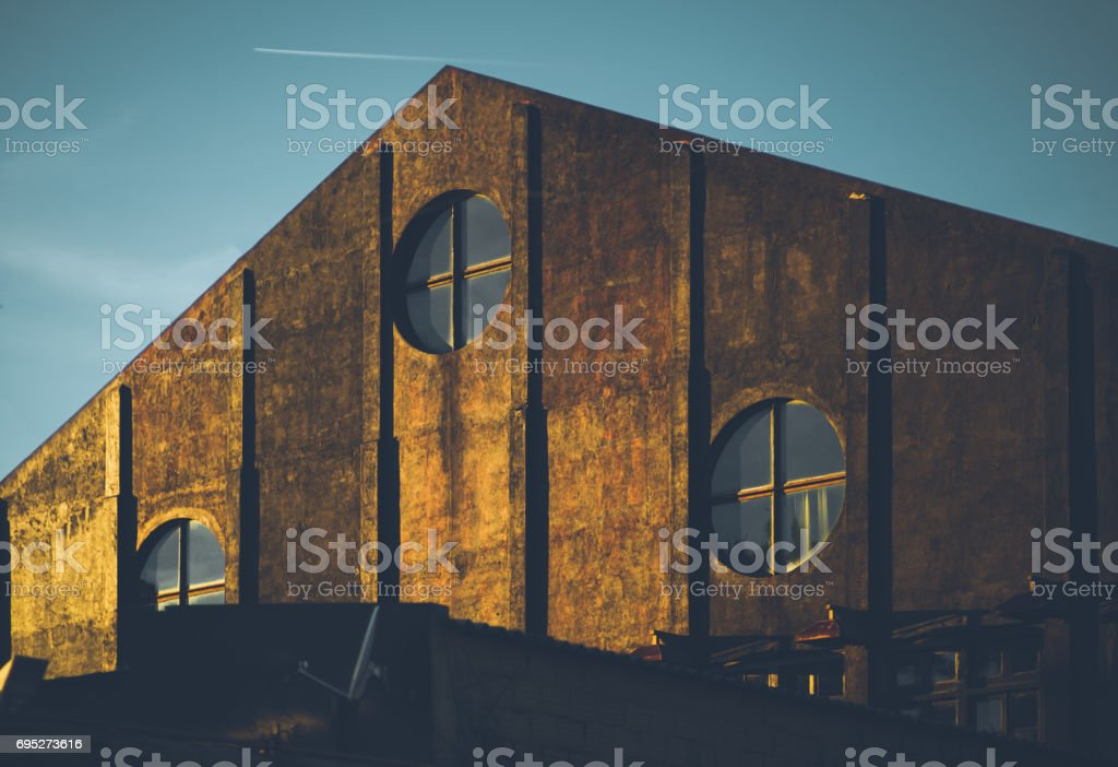 Facade of triangle warehouse building stock photo