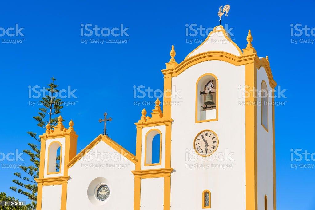Facade of typical church in Luz town on coast of Algarve region, Portugal