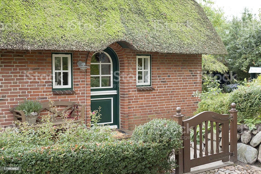 Facade of typical traditional home on island Sylt, Germany royalty-free stock photo