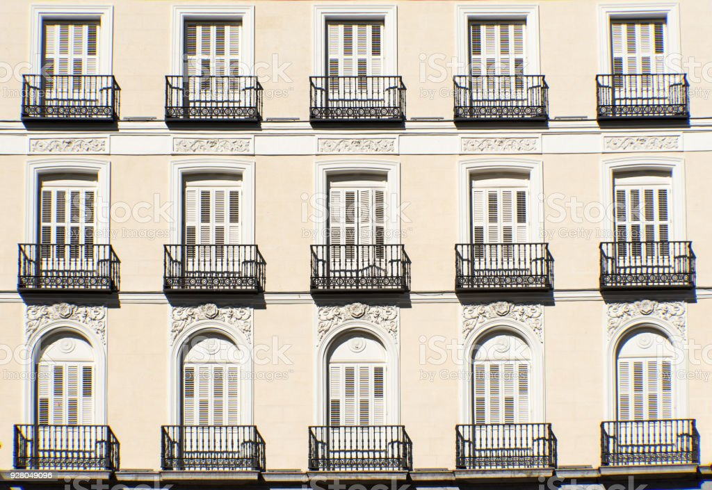 Facade with balconies in Madrid stock photo