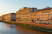 Facades in the evening light on the river in Florence