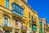 Facades of historical houses in the old town of Senglea, Malta