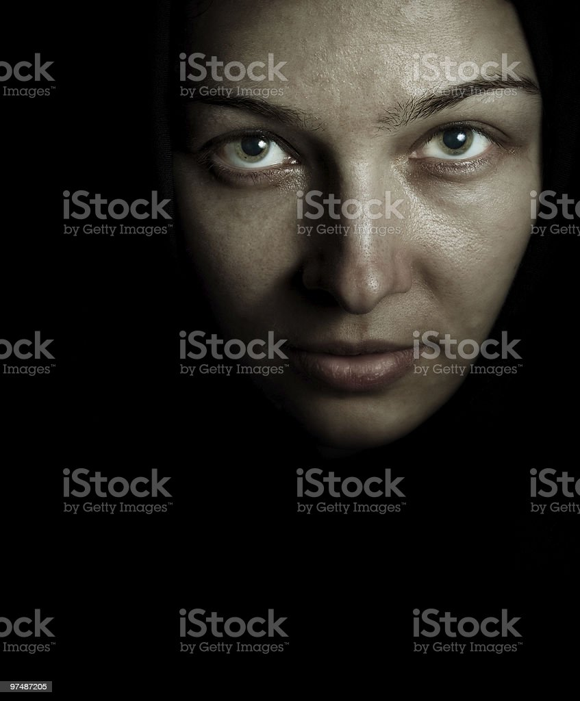 Face and eyes of spooky mystery woman in the dark royalty-free stock photo