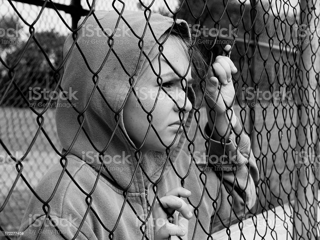 Face behind the fence #2 stock photo