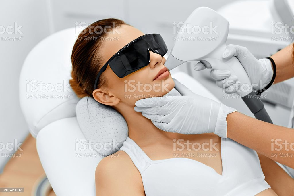 Face Care. Facial Laser Hair Removal. Epilation. Smooth Skin. stock photo