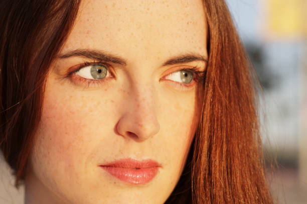face close up - woman green eyes red hair stock photos and pictures