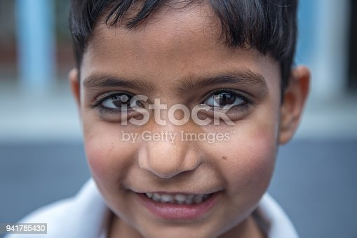941782244 istock photo Face close up portrait of a school girl smiling 941785430