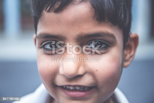 941782244 istock photo Face close up portrait of a school girl smiling 941785490
