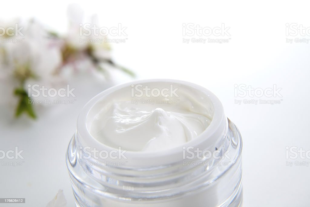 Face cream and almond flowers royalty-free stock photo