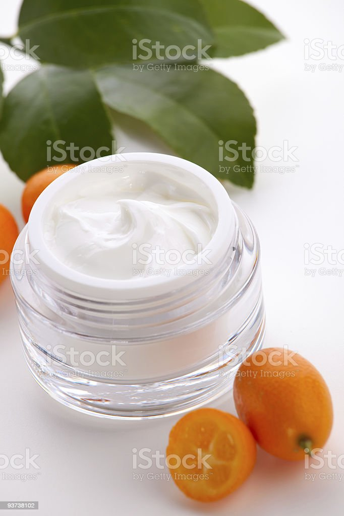 Face cream and fresh cumquats royalty-free stock photo
