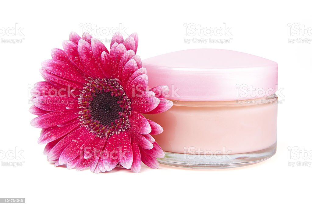 Face cream and gerbera flower with clipping path royalty-free stock photo