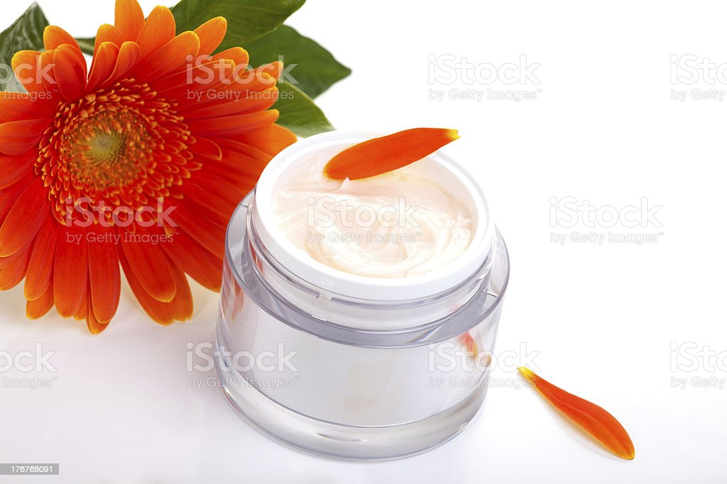 Face cream and gerbera flowers royalty-free stock photo