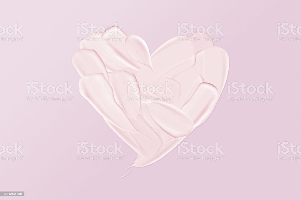 Face cream smudges in heart shape stock photo