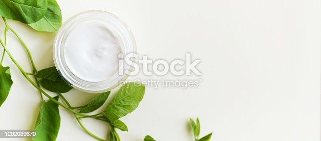847096968 istock photo face cream with green branch of mint on white background with a copy space 1202039670