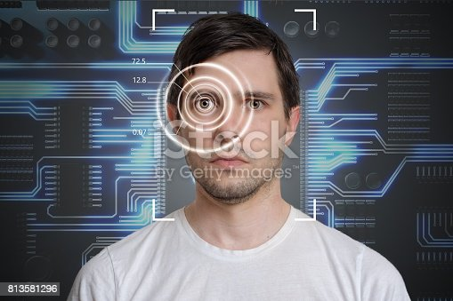 istock Face detection and recognition of man. Computer vision concept. Electronic circuit in background. 813581296
