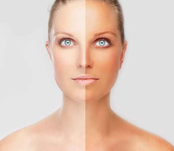face divided in two parts - tanned  and natural - zelfbruiner stockfoto's en -beelden