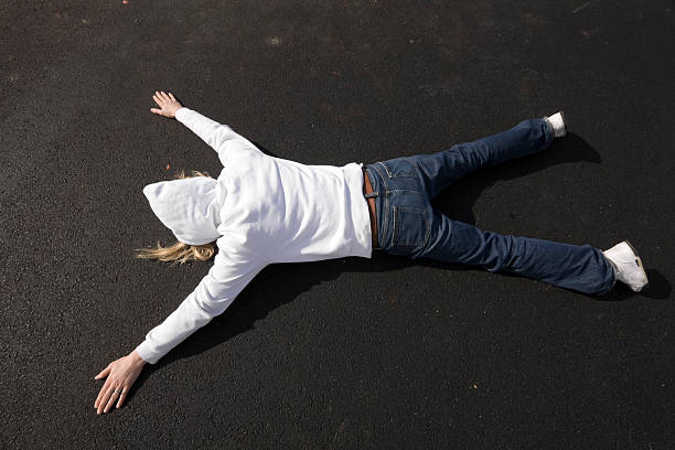 Face down on pavement  face down stock pictures, royalty-free photos & images