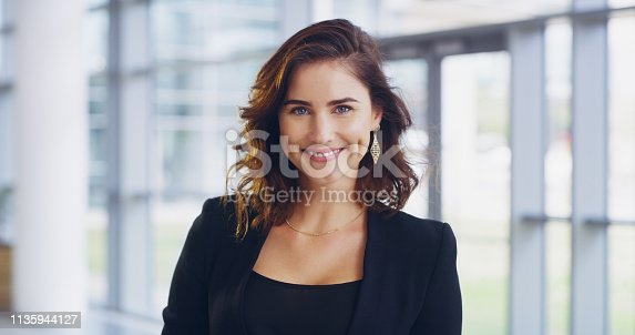 Cropped shot of a confident young businesswoman working in a modern office