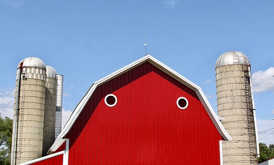 A face found in a red barn's windows