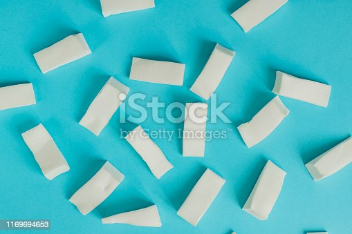Face foundation application tool and make up products concept with a blender sponge on blue background