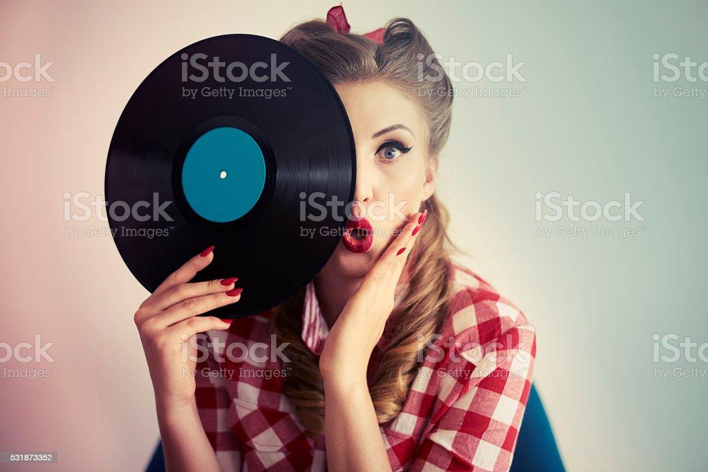 Face hidden behind the vinyl stock photo