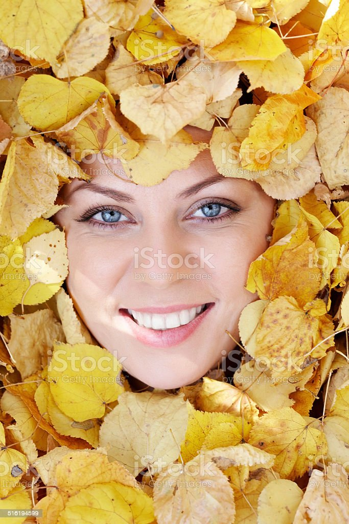 Face in foliage stock photo