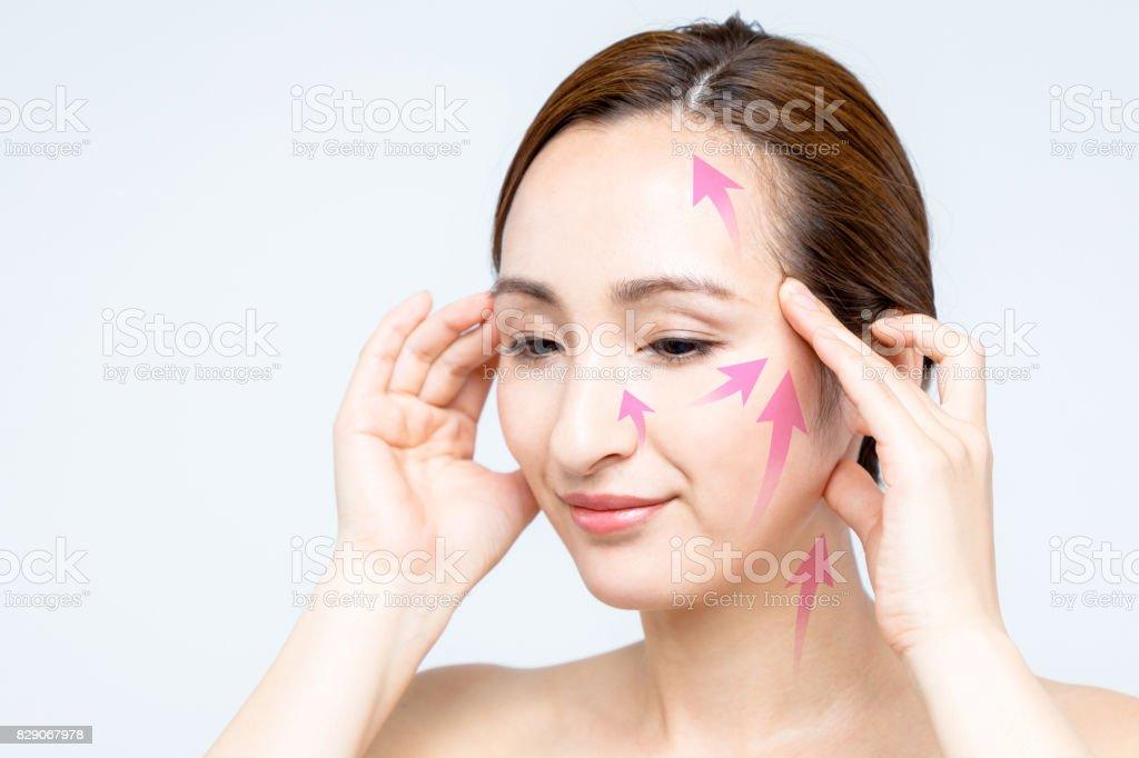 face lift up massage. women's beauty concept. stock photo
