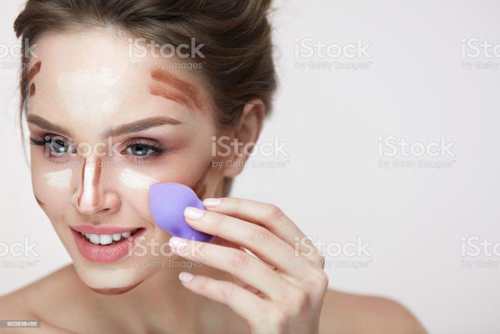 Face Makeup Beauty. Beautiful Female Applying Makeup With Sponge stock photo
