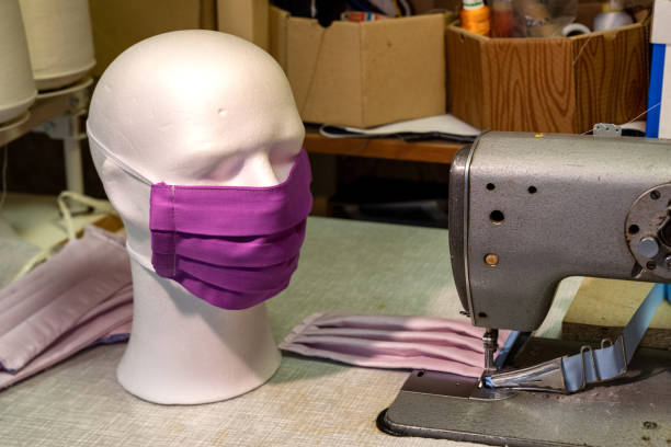 Face mask and sewing machine stock photo