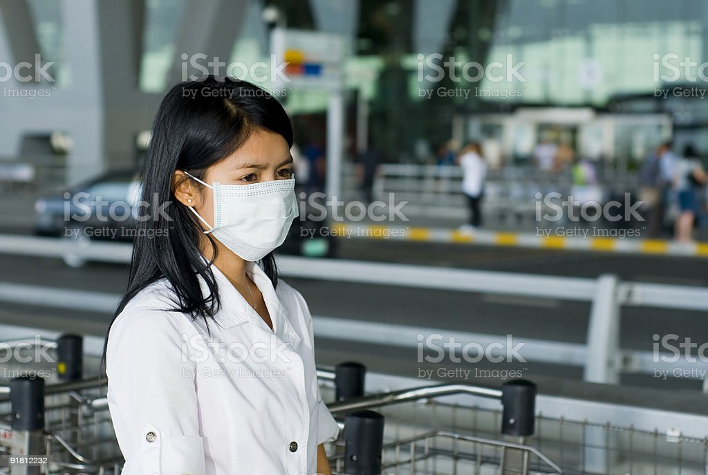 face mask at the airport stock photo