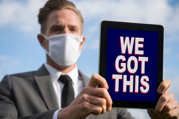 Face Mask Businessman Sharing Motivational Message stock photo