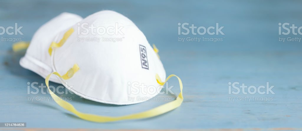 N95 Face Mask Protective Face Mask on a Blue wood  Background Blue Stock Photo