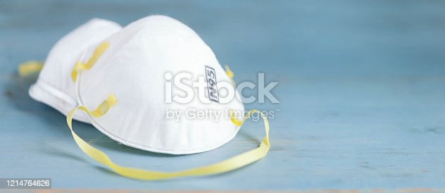 Protective Face Mask on a Blue wood  Background
