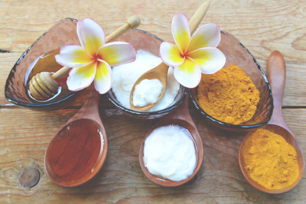 Face Mask with turmeric powder yogurt and honey for skin health. stock photo
