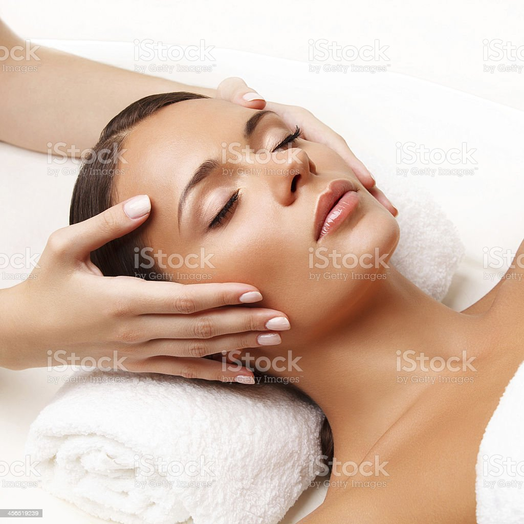 Face Massage.  Close-up of a Young Woman Getting Spa Treatment. stock photo