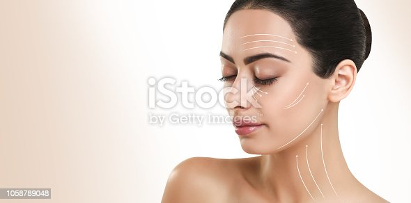 istock Face massage lines on perfect womans face 1058789048