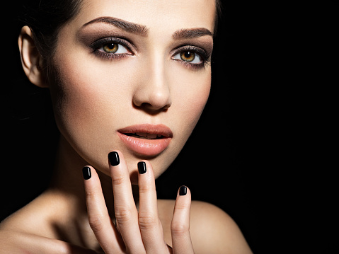 face of a beautiful girl with fashion makeup and black
